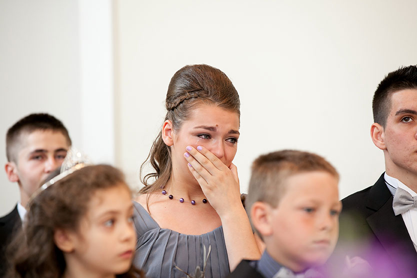 Bride's sister emotions during wedding ceremony
