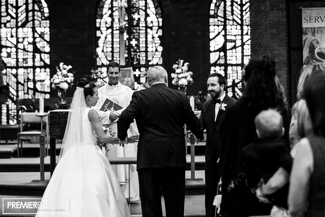 Bride being given away at the altar by her father