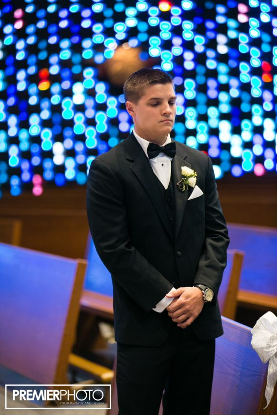 Groom waiting to see his bride at Saints Peter and Paul Catholic Church - Cary, IL