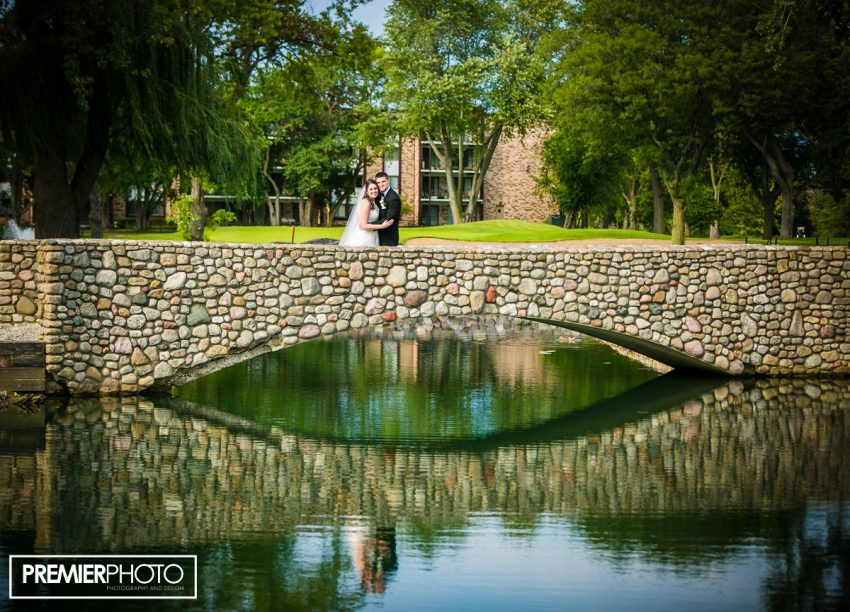 Bride and groom on the bridege. Old Orchard Country Club Mt. Prospect Wedding by Premier Photo