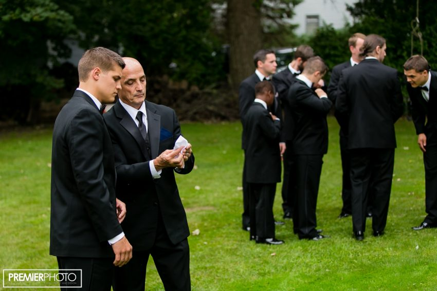 groom with his father. Wedding by Premier Photo