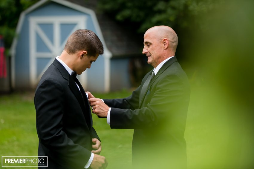 groom getting ready with his father. Wedding by Premier Photo