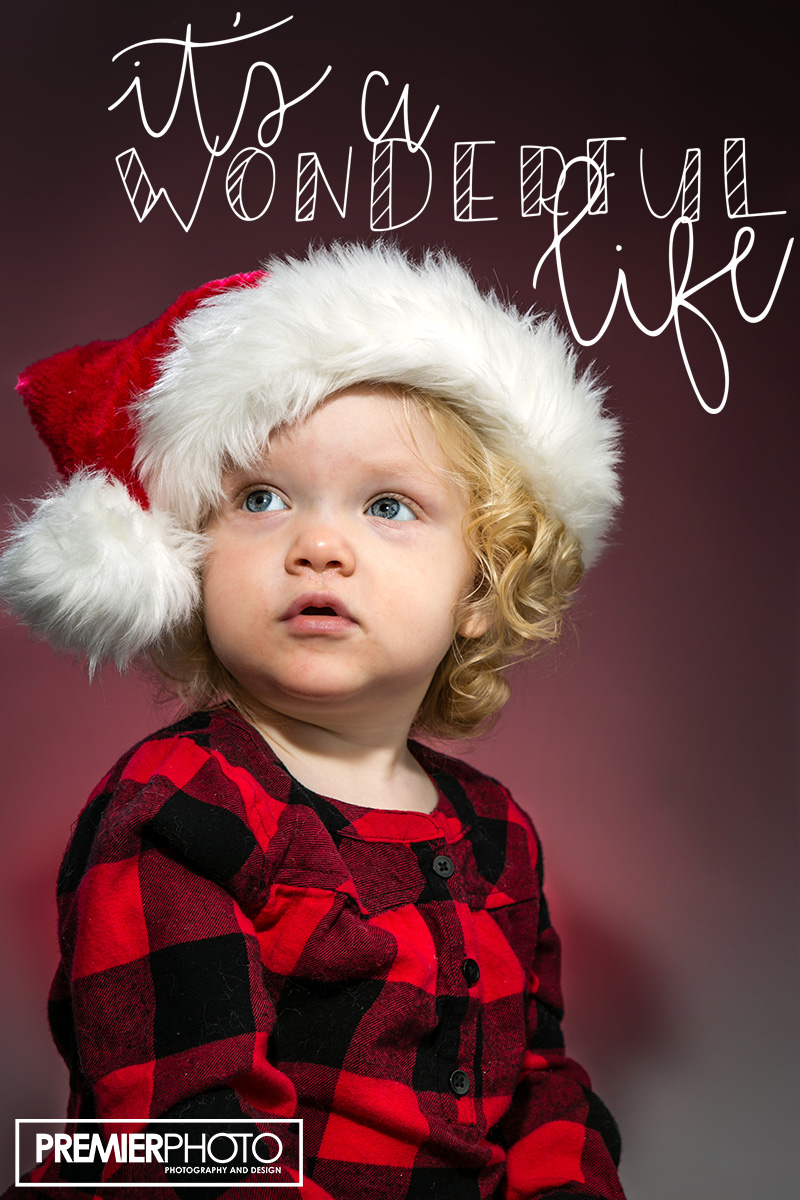 Young girl posing with Santa hat
