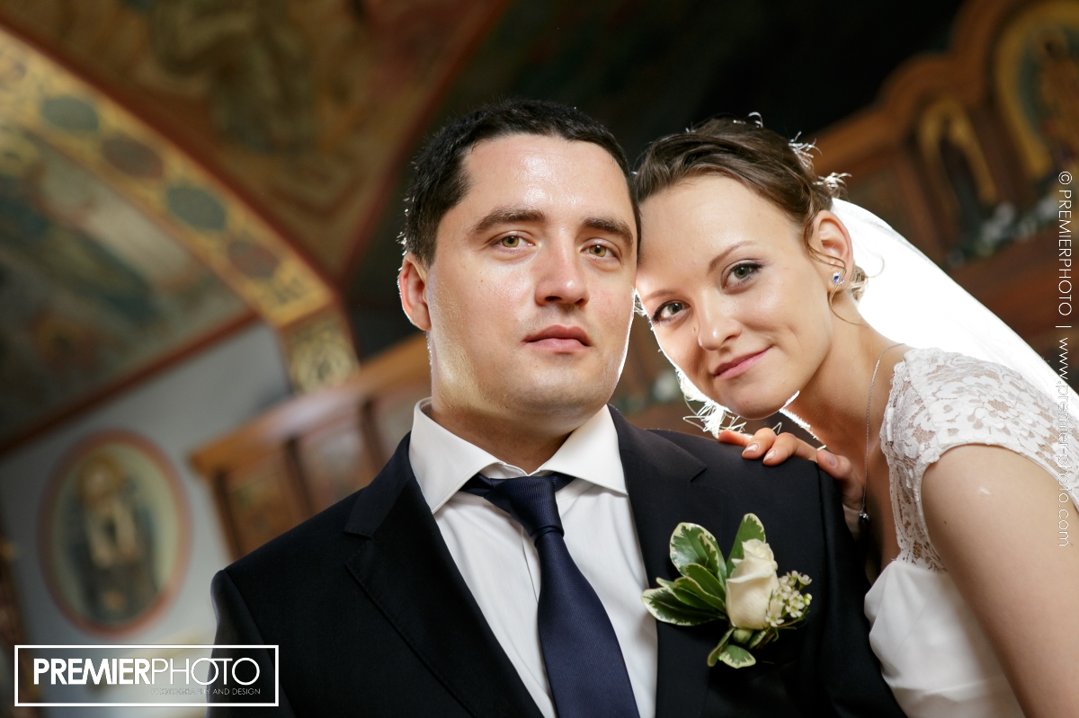 Portrait of just married young couple in the church