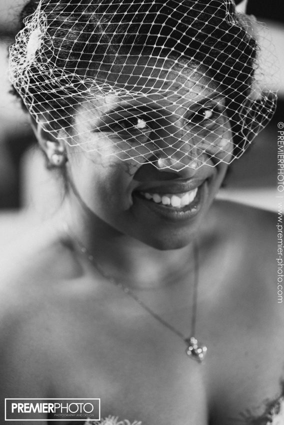 Portrait of beautiful latina bride wearing headpiece; black and white photography