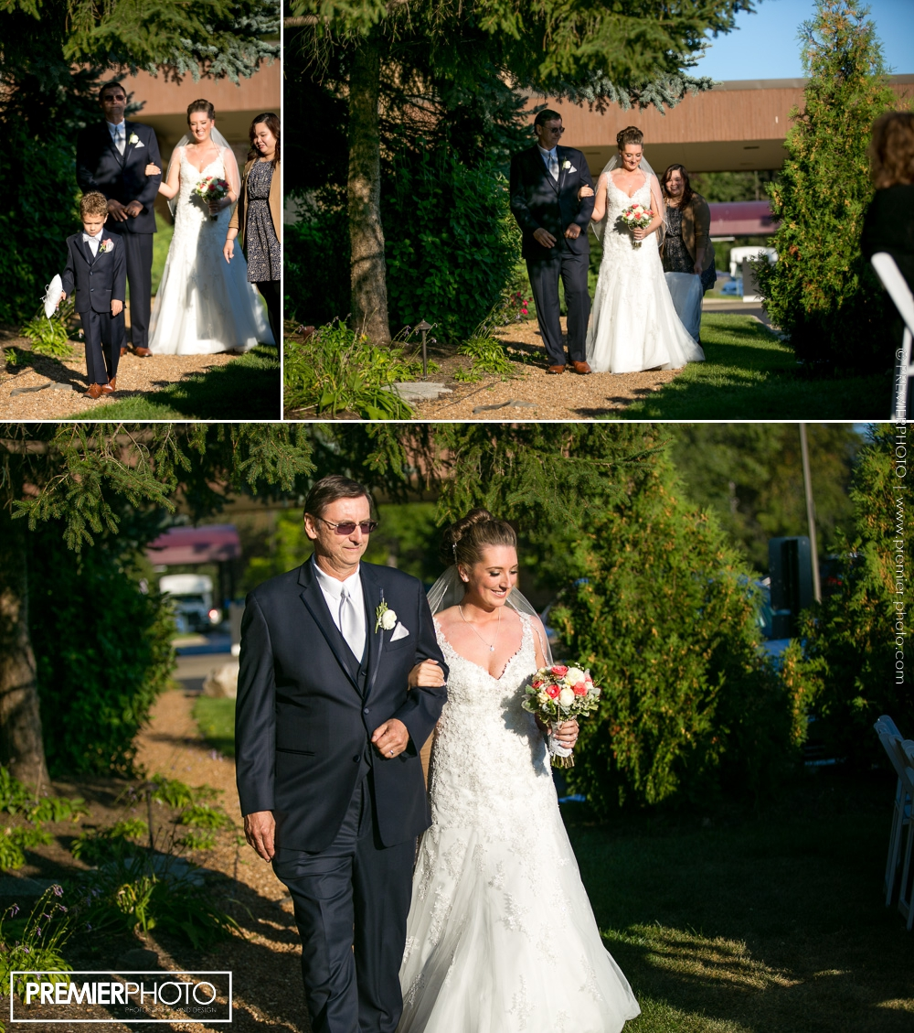 Bride walking the isle with her father; outdoor wedding ceremony - Hilton, Northbrook IL