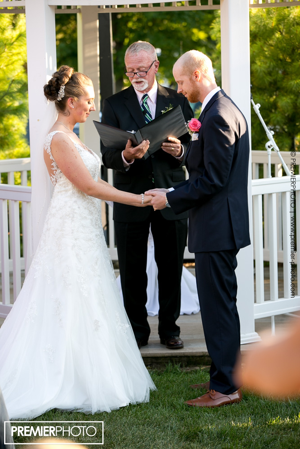 Officiant declaring newly weds husbandt and wife! Exceptional and elegant outdoor wedding ceremony