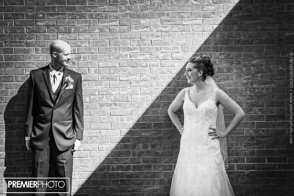 Contrast portrait of bride and groom before wedding ceremony, in black and white