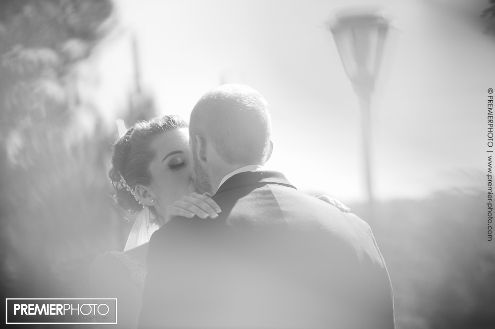 Soft photojournalistic style portrait of bride kissing her groom
