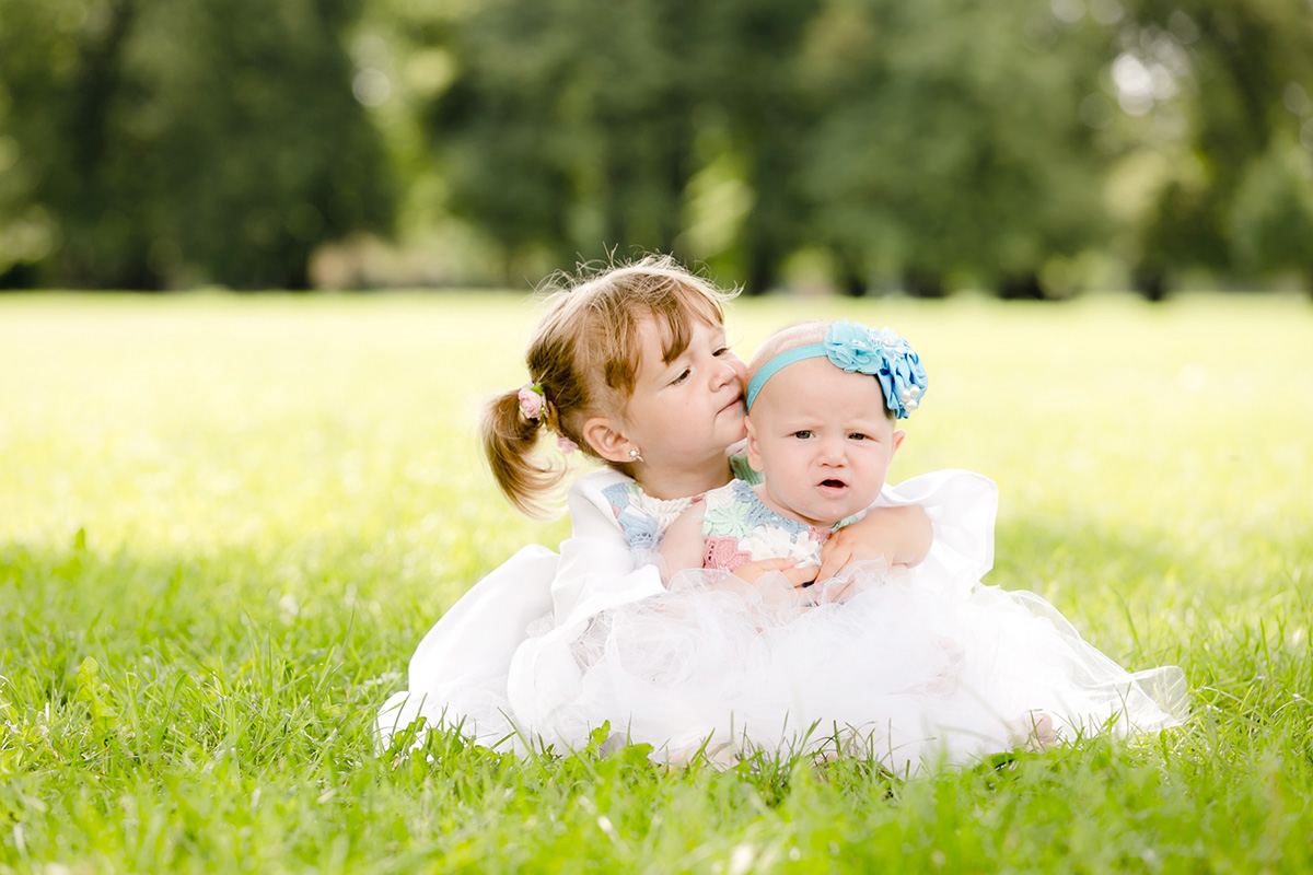 Portrait of young sisters in nature on a lovely summer day