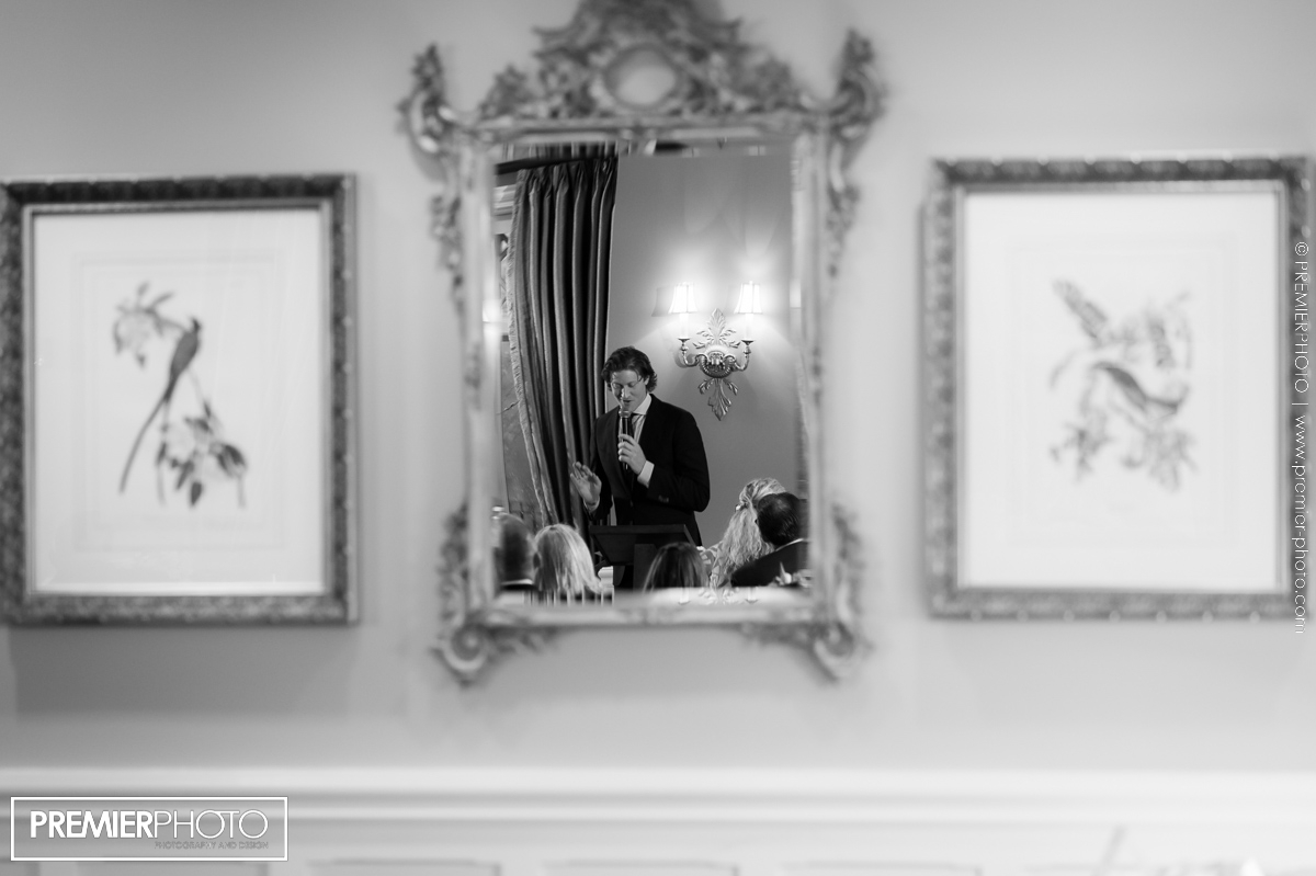 Mirror reflection of young man giving a speech at vows renewal wedding ceremony