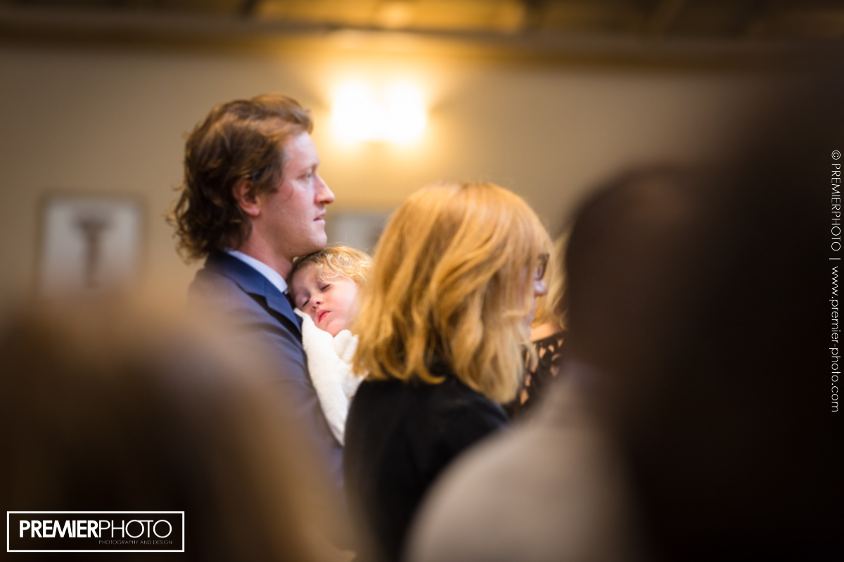 Vows renewal wedding ceremony. Young child asleep in his fathers arms