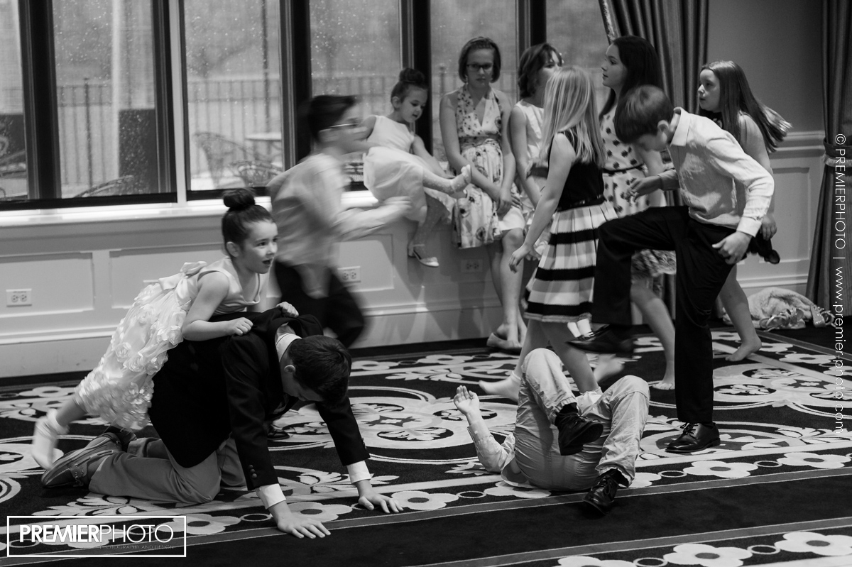 young children playing at the reception venue durig cocktail hour