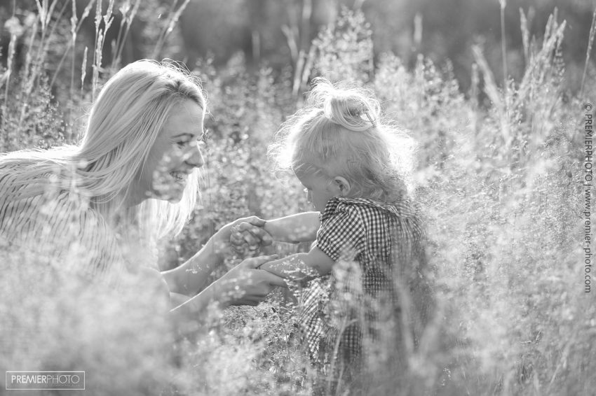 Family photo session outdoors with gorgeous mountain backdrop by #PremierPhoto